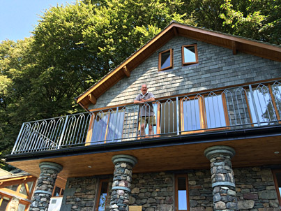 Picture of owner on his new extension with balcony above Grasmere (July 2014)
